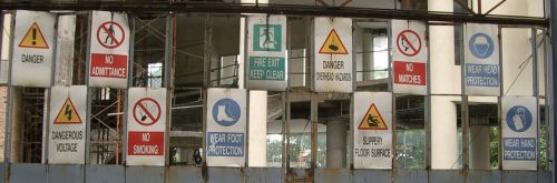A dozen warning signs on a construction site in KL