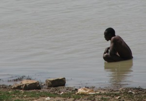 Pooping in the river, Mopti, Mali