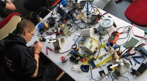A geek soldering at the CCC